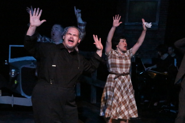 Zachary Allen Farmer as the Preacher and Kimi Short as Cumie Barrow, singing ''God''s Arms Are Always Open''