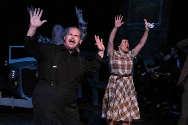 Zachary Allen Farmer as the Preacher and Kimi Short as Cumie Barrow, singing ''God''s Photo