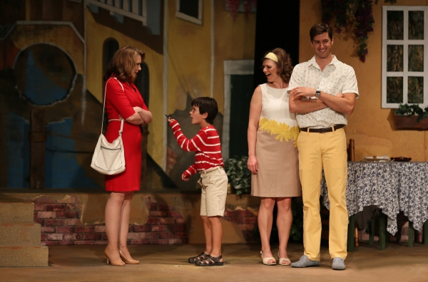 Leona Samish (Emily Skinner) is solicited by young Mauro (Jonah Broscow) as Jennifer Yaeger (Abby Sammons) and Eddie Yaeger (David Naughton) look on