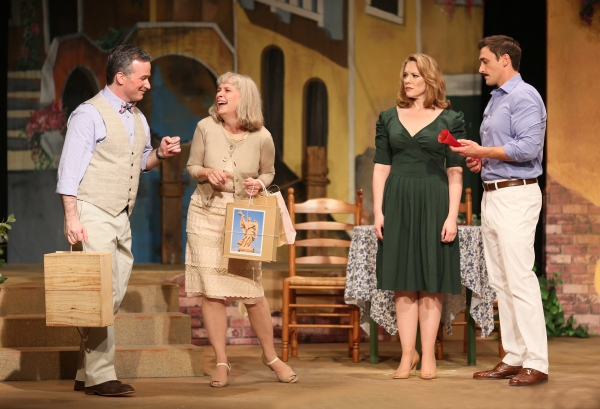 Lloyd McIIhenny (Michael Rhone) and Edith McIIhenny (Lucinda Hitchcock-Cone) show off their shopping treasures with Leona Samish (Emily Skinner) and Renato di Rossi (Tyler McKenna)