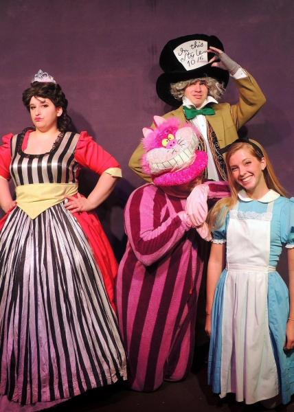 Tori Weaver as the Queen of Hearts, Jordan B. Stocksdale as the Cheshire Cat, Matt Rothenberg as the Mad Hatter, and Mary Ellen Cameron as Alice