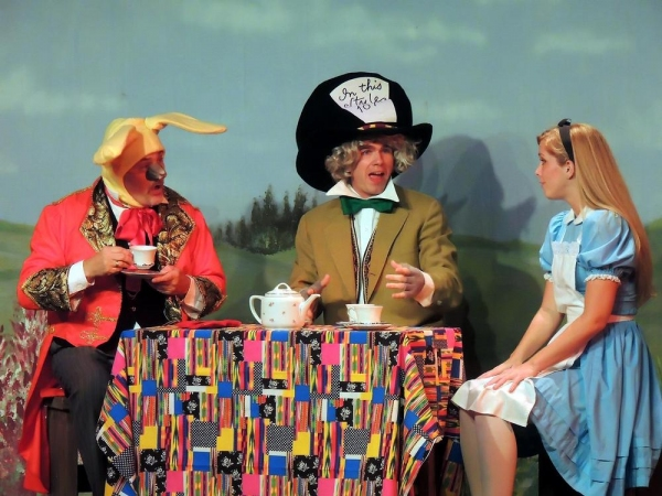 Bill Kiska as the March Hare, Matt Rothenberg as the Mad Hatter, and Mary Ellen Cameron as Alice