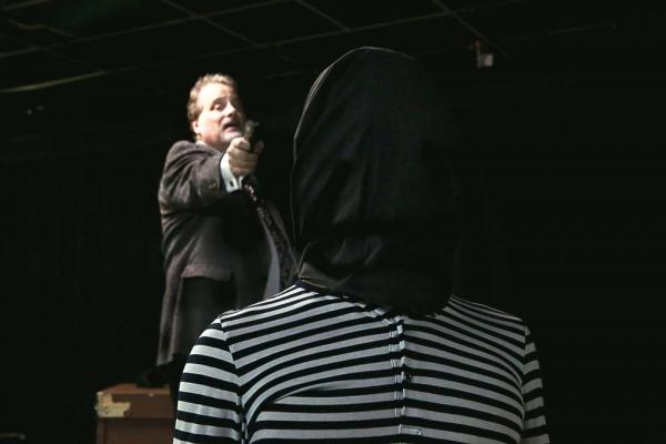 Tupolski (Scott Holmes) prepares to execute Katurian (Aaron Echegaray).