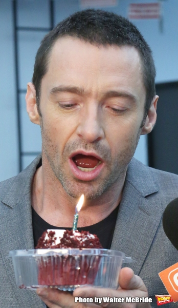 Extra offers Hugh Jackman a birthday cupcake at the meet & greet for ''The River''  at their rehearsal studio on October 14, 2014 in New York City.