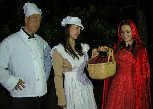 The Baker (Terry Delegeane) and his Wife (Amy Coles) give a basket of sweets to Little Red Ridinghood (Carly Linehan) to take to her Granny. � with Terry Delegeane, Amy Coles and Carly Linehan.