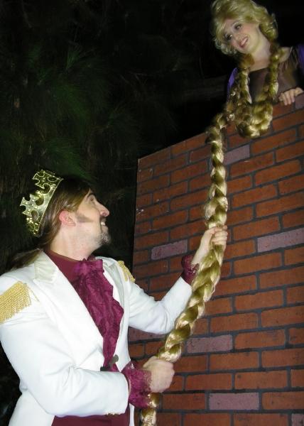 Rapunzel (Alicia Reynolds) lets down her hair to her Prince (Matthew Artson). ââ Photo