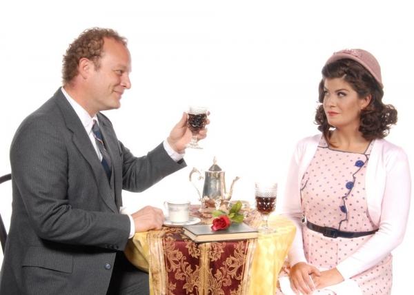 Paul Angelo as Georg toasts Dru Rutledge as Amalia Photo