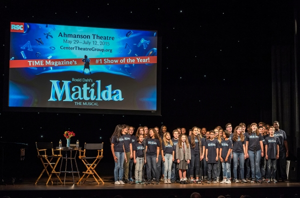 A chorus from the Colburn Community School of Performing Arts perform with former Broadway MATILDA Bailey Ryon (center in costume)