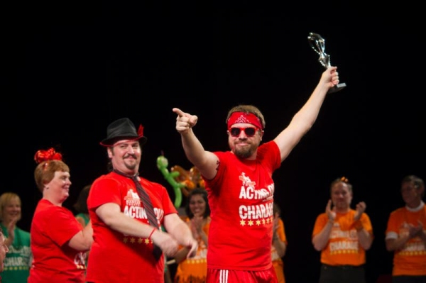 Charades Champion''s Remarkable Reds team members Kelly Jackson, Bruce Warren, Jamie Wells
