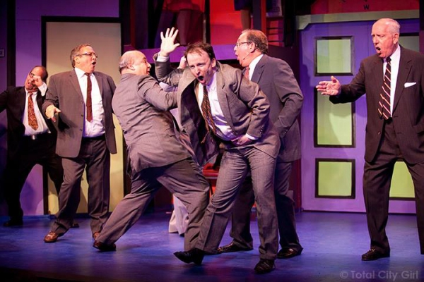 Patrick Dwyer (center) and the men of HOW TO SUCCEED
