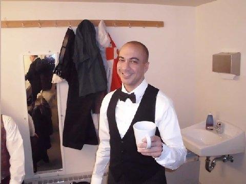 Evan Zes as The Waiter.