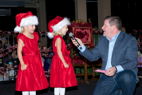 Santa for a Day contest winner Nicole La Fond and her twin sister Natalie (pictured here with Old Globe Managing Director Michael G. Murphy) helped light the tree