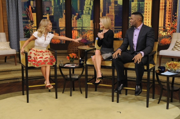 Kelly Ripa and Michael Strahan are pictured with Kristin Chenoweth