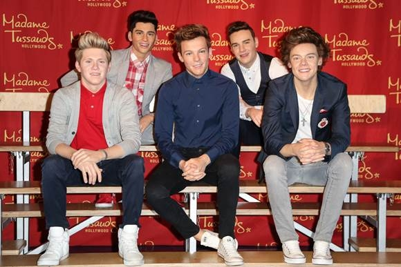 Following their three American Music Award wins for Artist of the Year, Favorite Band, Duo or Group - Pop/Rock, and Favorite Album - Pop/Rock, Madame Tussauds Hollywood launched the One Direction figures this morning on their rooftop.