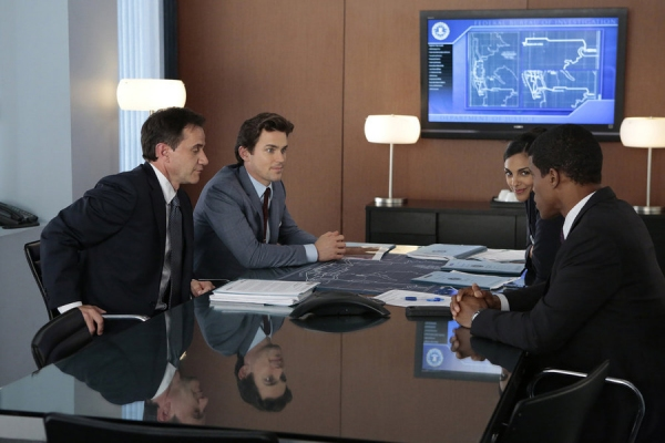 Tim DeKay as Peter Burke, Matt Bomer as Neal Caffrey, Marsha Thomas as Diana Barrigan, Sharif Atkins as Clinton Jones