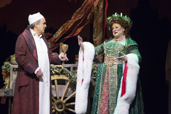 Edward Gero as Scrooge and Anne Stone as the Ghost of Christmas Present Photo