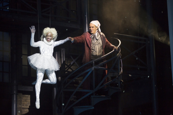 Felicia Curry as Ghost of Christmas Past and Edward Gero as Scrooge