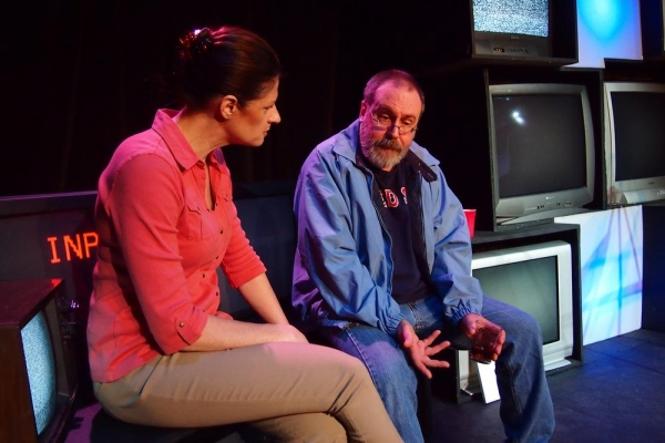 Celia Adams as Morgan and Michael Moore as Conrad