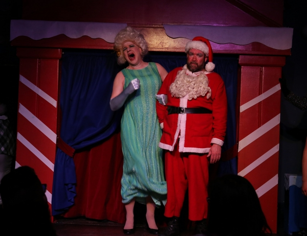 Santa''s wife, Ruth (Ed Jones), humiliates Santa (Michael Hampton) on national televi Photo