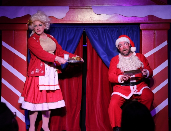 Mrs. Claus (Ed Jones) tires to convince Santa (Michael Hampton) to eat something Photo
