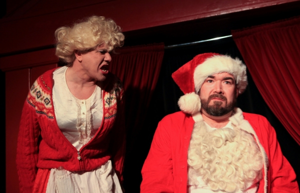 All is not merry at the Claus home as Mrs. Claus (Ed Jones) tries to talk to an unresponsive Santa (Michael Hampton)