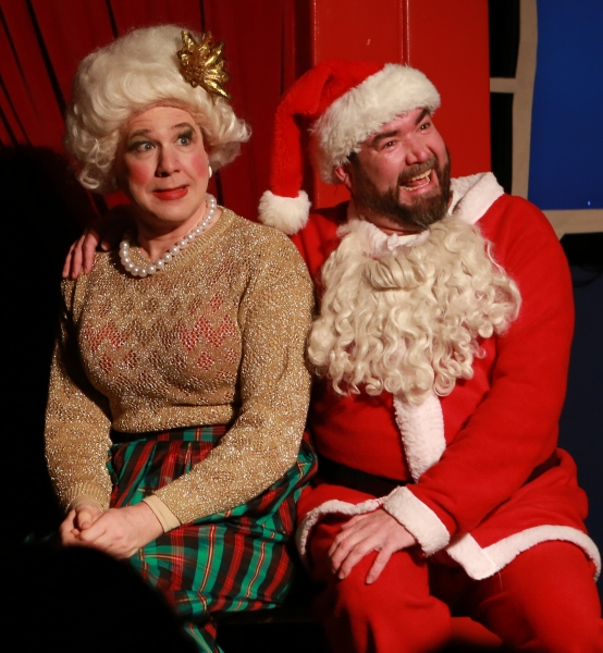 Mrs. Claus (Ed Jones) tries to hold it together long enough to get through a televised interview in order to please Santa (Michael Hampton)