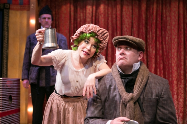 Peter Boyer (Scrooge) and the Cratchits (Tracey Stephens and Michael Sharp