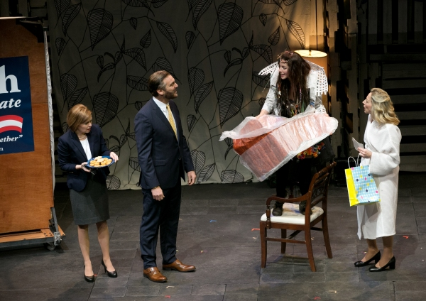 Romi brings a present to her mom - Nicole Lowrance as Kansas, Michael T. Weiss as Bru Photo