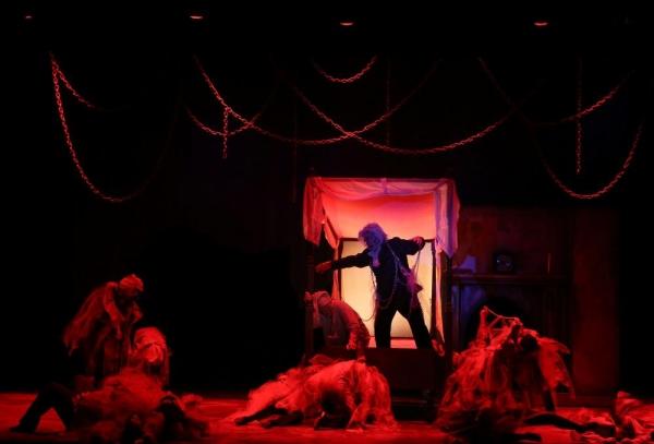 Scrooge (Joel Rainey), Ghost of Jacob Marley (Alan Payne) and the ensemble