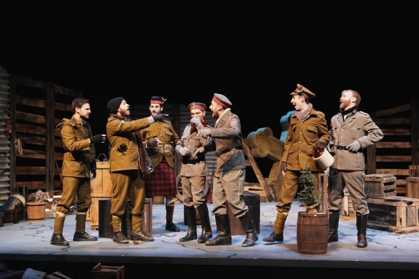 British and German soldiers celebrate Christmas. Left to right: Jared Earland, Aaron Epstein, Matt Krieg, Michael Gettinger, Patrick McWillilams, Jack Manion, Jeffrey K. Miller. (Photo by Mikki Schaffner)