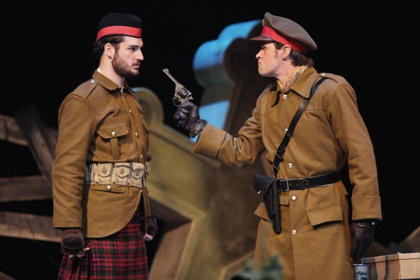 A British lieutenant (Carter Bratton) threatens to shoot a sergeant (Matt Krieg) for fraternizing with the enemy. (Photo by Mikki Schaffner)