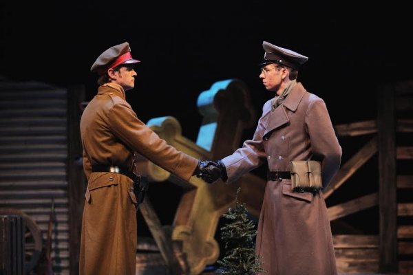 A British officer reluctantly shakes hands with his German counterpart. Left to right: Carter Bratton and Robert Macke. (Photo by Mikki Schaffner)