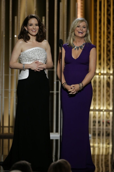 72nd ANNUAL GOLDEN GLOBE AWARDS -- Pictured: (l-r) Tiny Fey, Amy Poehler, Hosts at the 72nd Annual Golden Globe Awards held at the Beverly Hilton Hotel on January 11, 2015 -- (Photo by: Paul Drinkwater/NBC)