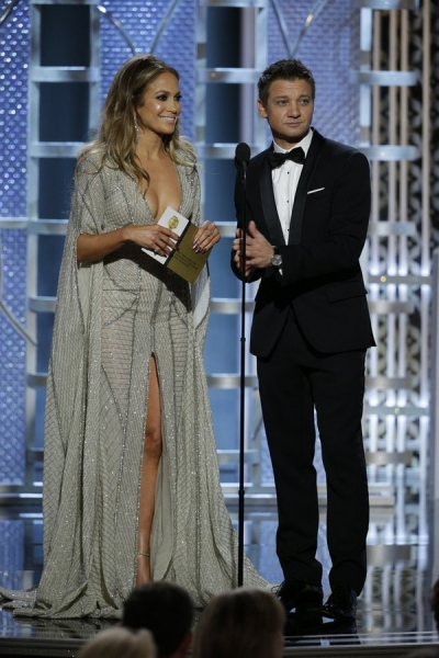 72nd ANNUAL GOLDEN GLOBE AWARDS -- Pictured: (l-r) Jennifer Lopez, Jeremy Renner, Presenters at the 72nd Annual Golden Globe Awards held at the Beverly Hilton Hotel on January 11, 2015 -- (Photo by: Paul Drinkwater/NBC)