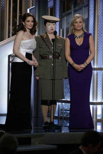 72nd ANNUAL GOLDEN GLOBE AWARDS -- Pictured: (l-r) Tiny Fey, Host; Margaret Cho, Amy Poehler, Host at the 72nd Annual Golden Globe Awards held at the Beverly Hilton Hotel on January 11, 2015 -- (Photo by: Paul Drinkwater/NBC)