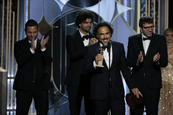 "72nd ANNUAL GOLDEN GLOBE AWARDS -- Pictured: Alejandro Gonzalez Inarritu, ""Birdman"", Winner, Best Screenplay - Motion Picture, with Alexander Dinelaris, Armando Bo, Nicolas Giacobone at the 72nd Annual Golden Globe Awards held at the Beverly Hilton Hotel"