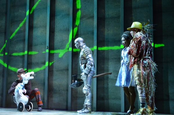 A mouse (puppet operated by Austin Carroll) addresses the Tinman (Tyrick Wiltez Jones), Dorothy (Destinee Rea) and the Scarecrow (David LaMarr) outside the gates of Oz