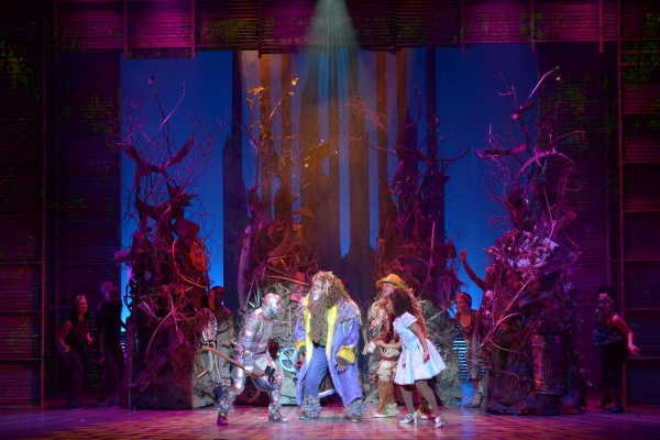 The Tinman (Tyrick Wiltez Jones), the Lion (Trevor Dion Nicholas), the Scarecrow (David LaMarr) and Dorothy (Destinee Rea) make their way through the forest