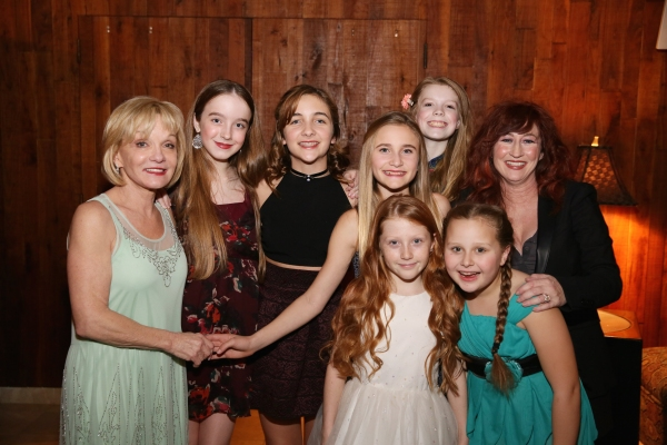 Executive Producer Cathy Rigby (left) and cast member Vicki Lewis (right) pose with the ensemble dancers