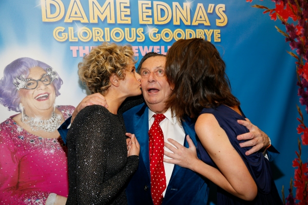 Cast members Eve Prideaux and Brooke Pascoe kiss Dame Edna creator and performer Barry Humphries