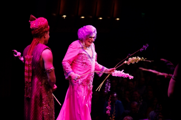 Dame Edna and the cast throw gladiolas to the audience