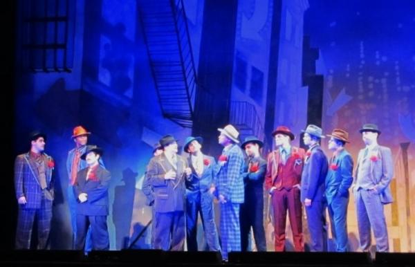 John Galas as Big Jule and the male ensemble Photo