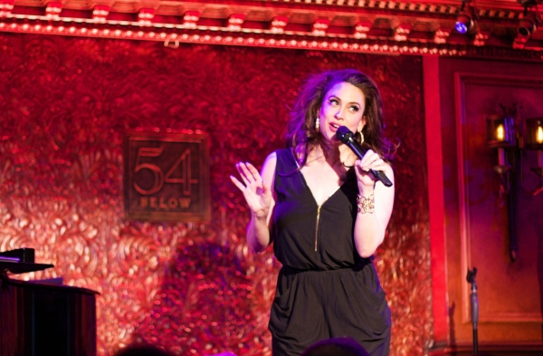 Lesli Margherita explains how the evening will run, and the one rule: DRINK.