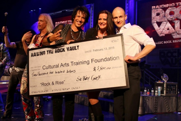 Jay Schellen and Carol-Lyn Liddle present the check to Tolerance Parvin, Executive Di Photo