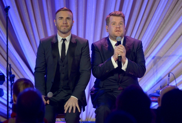 LOS ANGELES, CA - FEBRUARY 21:  Singer Gary Barlow (L) and actor/comedian James Corden speak onstage during The Weinstein Company's Academy Awards Nominees Dinner in partnership with Chopard, DeLeon Tequila, FIJI Water and MAC Cosmetics on February 21, 2