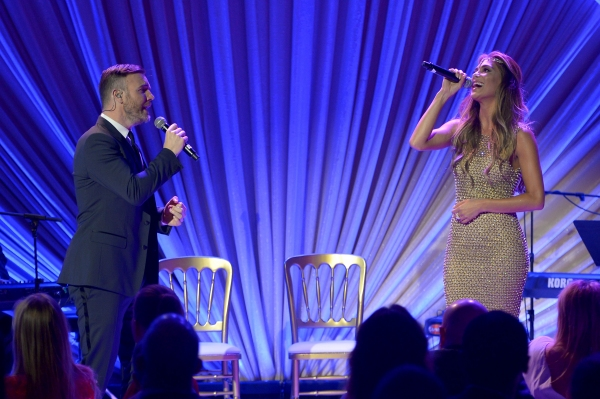 LOS ANGELES, CA - FEBRUARY 21:  Singers Gary Barlow (L) and Nicole Scherzinger perform onstage during The Weinstein Company's Academy Awards Nominees Dinner in partnership with Chopard, DeLeon Tequila, FIJI Water and MAC Cosmetics on February 21, 2015 in