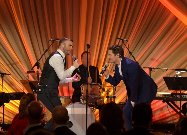 LOS ANGELES, CA - FEBRUARY 21:  Singer Gary Barlow (L) and actor Matthew Morrison perform onstage during The Weinstein Company's Academy Awards Nominees Dinner in partnership with Chopard, DeLeon Tequila, FIJI Water and MAC Cosmetics on February 21, 2015