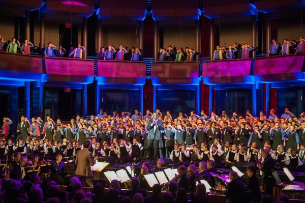 Gala host Norm Lewis and YPC choristers on stage to open the show