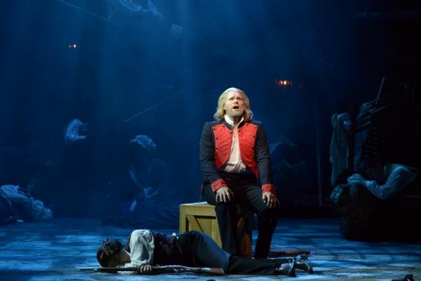 Valjean (Gregg Goodbrod) sings as Marius (Joshua Charles Skurnik) sleeps