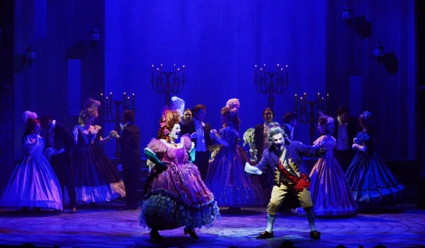 Mme. Thenardier (Margot Moreland) and Thenardier (Richard Vida) dance and sing while  Photo